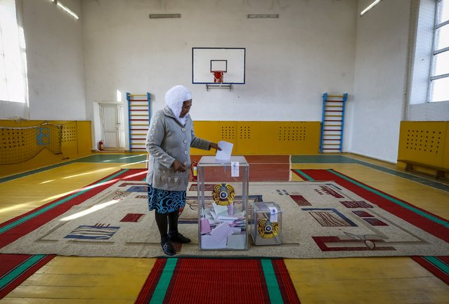 A woman casts her ballot during a snap parliamentary election in a sport hall used for a polling station in a village of Toretam, southern Kazakhstan, March 20, 2016. (Photo by Shamil Zhumatov/Reuters)