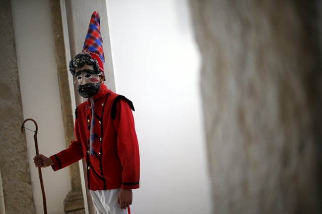 """A member of the """"Velhos de Bruco"""" folk group poses for a portrait before the parade of the 10th International Festival of the Iberian Mask in Lisbon, Portugal May 9, 2015. (Photo by Rafael Marchante/Reuters)"""