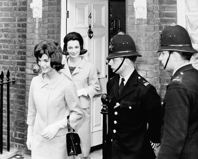 In this June 6, 1961 file photo,  Jacqueline Kennedy is followed by her sister, Lee Radziwill, in London. Radziwill, the stylish jet setter and socialite who made friends worldwide even as she bonded and competed with her older sister Jacqueline Kennedy, has died. She was 85. Anna Christina Radziwill told The New York Times her mother died Friday, Feb. 15, 2019, of what she described as natural causes. (Photo by AP Photo/File)