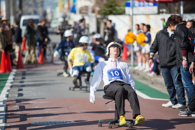 Competitors race to exhaustion during the ISU-1 Grand Prix on March 26, 2016 in Kyotanabe, Japan. In the Isu-1 Grand Prix or chair-one grand prix, a two hour endurance race, participants compete on an office chair balancing the speed and the chairs' ability to race for 2 hours without critical damage. (Photo by Trevor Williams/Getty Images)