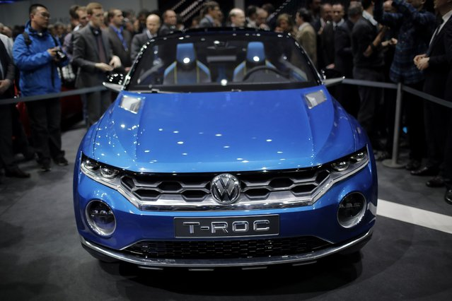 The new Volkswagen T-Roc, urban SUV concept car is introduced during a preview show of Volkswagen Group, as part of the 84th Geneva International Motor Show, Switzerland, Monday, March 3, 2014. (Photo by Laurent Cipriani/AP Photo)
