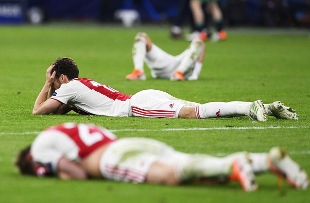 Players of Ajax Amsterdam react after the UEFA Champions League semi final, second leg soccer match between Ajax Amsterdam and Tottenham Hotspur in Amsterdam, The Netherlands, 08 May 2019. (Photo by Olaf Kraak/EPA/EFE)