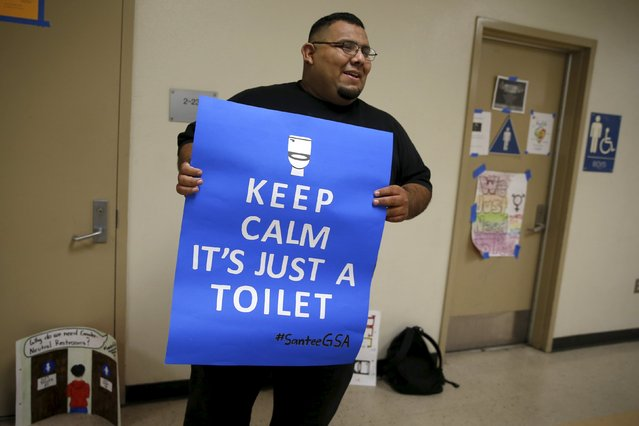 Jose Lara, 34, Dean of Students & GSA Advisor, holds a sign which was part of the campaign for the first gender-neutral restroom in the Los Angeles school district at Santee Education Complex high school in Los Angeles, California, U.S., April 18, 2016. (Photo by Lucy Nicholson/Reuters)