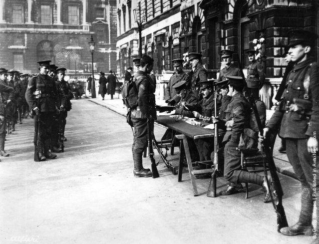 1914: Members of the 15th London Regiment receive their pay outside Somerset House, soon after mobilisation