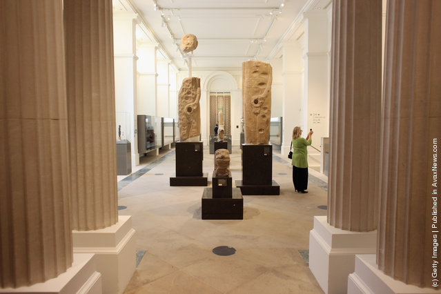 A woman takes a photograph on her mobile phone in the Ashmolean Museum's new exhibition of artifacts from ancient Egypt and Nubia