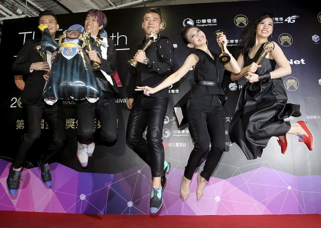 Singer Penny Tai (2nd R) and other members of Taiwan band Buddha Jump celebrate after winning the Best Band category at the 26th Golden Melody Awards in Taipei, Taiwan, June 27, 2015. (Photo by Toby Chang/Reuters)