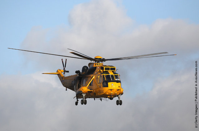 A Royal Air Force search and rescue helicopter leaves RAF Valley as the search continues for the crew of cargo vessel The Swanland which sank off north Wales on November 27, 2011 in Anglesey, Wales