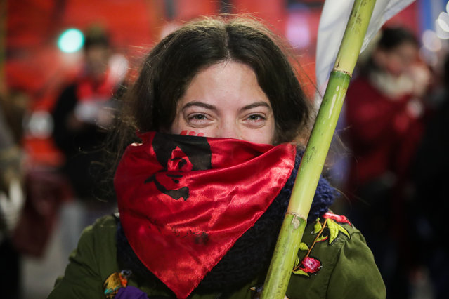 A woman takes part in a march in Montevideo, Uruguay, 14 August 2019. Each 14 August, people in Montevideo participate in the March of the Student Martyrs, in honor of the students killed or kidnapped during the last Uruguayan dictatorship (1973-1985). The chosen date coincides with the death date of of student activist Liber Arce in 1968. (Photo by Raul Martinez/EPA/EFE)