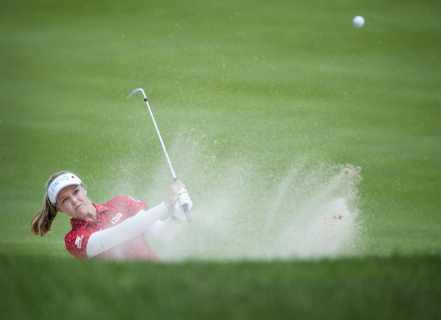 Canada's Brooke Henderson blasts out of the bunker on the 14th hole during the second round of the CP Women's Open golf tournament in Aurora, Ontario, Friday, August 23, 2019. (Photo by Nathan Denette/The Canadian Press via AP Photo)