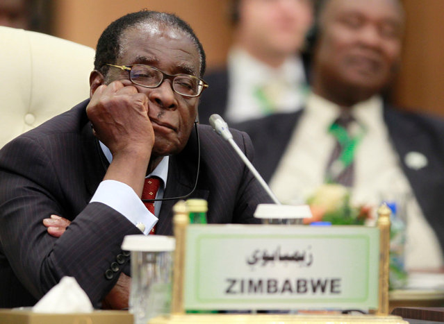 Zimbabwe's President Robert Mugabe sleeps during the speech of Libya's leader Muammar Gaddafi at the start of the third European Union-Africa summit in Tripoli November 29, 2010. Gaddafi warned the European Union on Monday that Africa would turn to other trade partners if the EU kept trying to dictate to the continent how it should develop. On Friday, September 6, 2019, Zimbabwe President Emmerson Mnangagwa said his predecessor Mugabe, age 95, has died. (Photo by Francois Lenoir/Reuters)