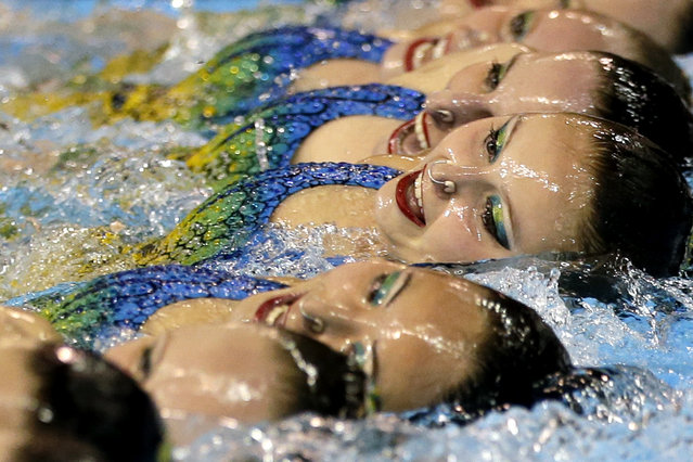 Members of Canada's synchronized swimming team perform during technical routine competition for the Pan Am Games in Toronto, Thursday, July 9, 2015. (Photo by Gregory Bull/AP Photo)