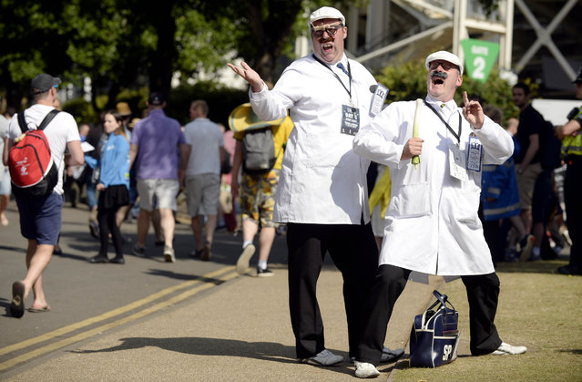 Cricket, England vs Australia, Investec Ashes Test Series First Test – SWALEC Stadium, Cardiff, Wales on July 11, 2015: Entertainers dressed as cricket umpires outside the ground. (Photo by Philip Brown/Reuters)