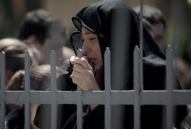 The girlfriend of Andrei Brazhevskiy, a pro-Russian activist, cries during his funeral in Odessa, Ukraine, Wednesday, May 7, 2014. Brazhevskiy, 27, died after jumping out of the burning trade union building in an attempt to escape Friday's fire that killed most of the 40 people that died after riots erupted last Friday. (Photo by Vadim Ghirda/AP Photo)