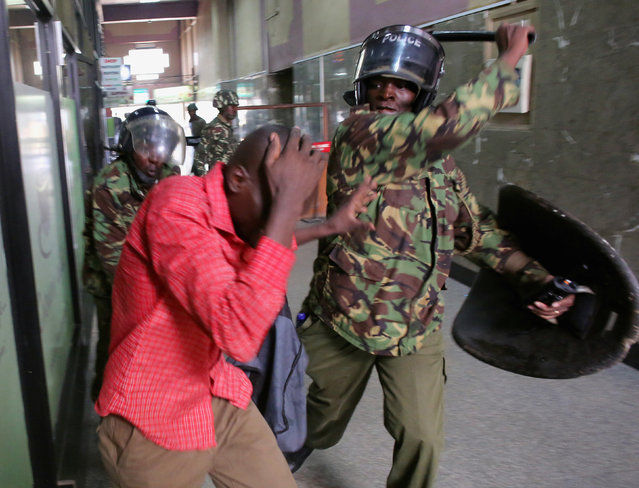 Policemen beat a protester inside a building during clashes in Nairobi, Kenya May 16, 2016. (Photo by Goran Tomasevic/Reuters)