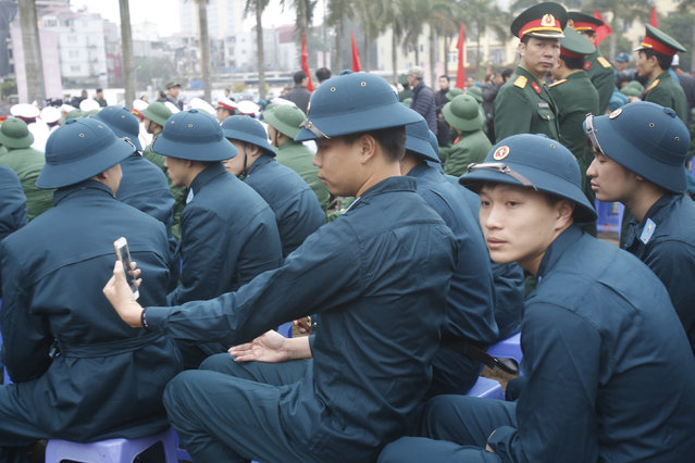A new recruit takes a selfie during a military recruitment ceremony at the Quan Ngua stadium in Hanoi, Vietnam, February 23, 2016. (Photo by Reuters/Kham)