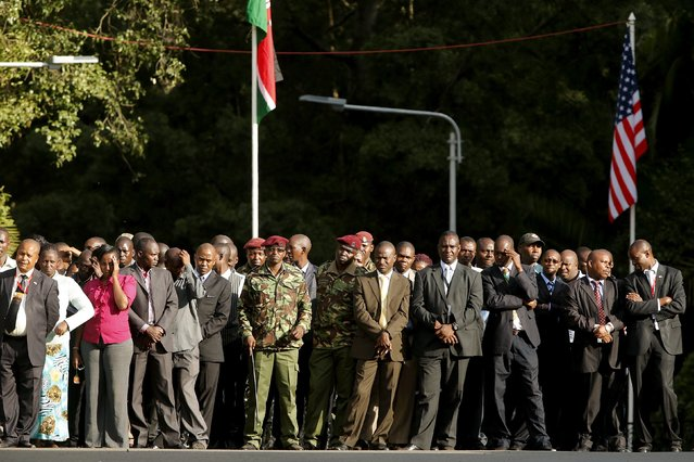 Kenyan staff members look on as U.S. President Barack Obama and Kenya's President Uhuru Kenyatta (neither pictured) hold a joint news conference after their meeting at the State House in Nairobi July 25, 2015. (Photo by Jonathan Ernst/Reuters)