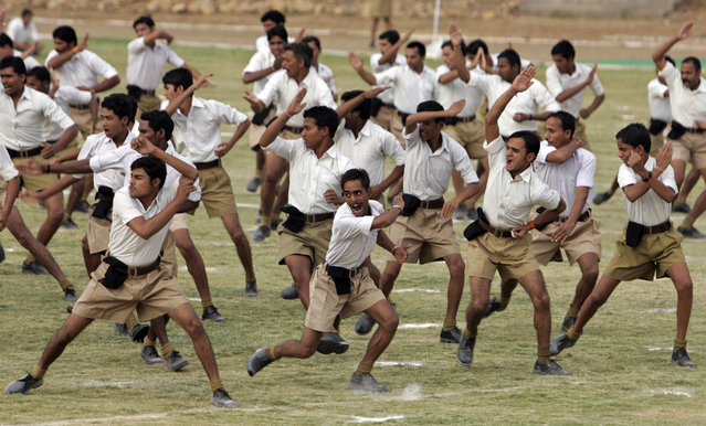 Volunteers of the Rashtriya Swayamsevak Sangh (RSS), India's Hindu nationalist organisation, take part in a drill during a training camp in the central Indian city of Bhopal June 7, 2014. (Photo by Raj Patidar/Reuters)