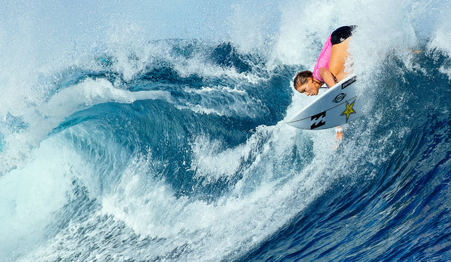 This handout photo taken and released on May 31, 2016 by the World Surf League shows Courtney Conlogue in action during her quarter-final at the Fiji Women's Pro at Tavarua. Johanne Defay of France clinched her maiden World Tour victory, defeating Carissa Moore of the US with Bethany Hamilton of the US placed third. (Photo by Ed Sloane/AFP Photo/World Surf League)