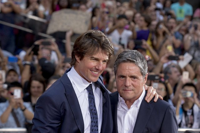 """Actor Tom Cruise poses with Chairman and CEO of Paramount Pictures Brad Grey  on the red carpet for a screening of the film """"Mission Impossible: Rogue Nation"""" in New York July 27, 2015. (Photo by Brendan McDermid/Reuters)"""