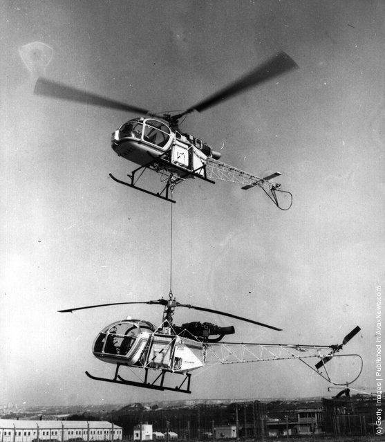 1972: The great lifting power of the French helicopter 'The Lama'  currently in production at the Marignana aircraft factory is displayed where it is lifting an Alouette Mark II