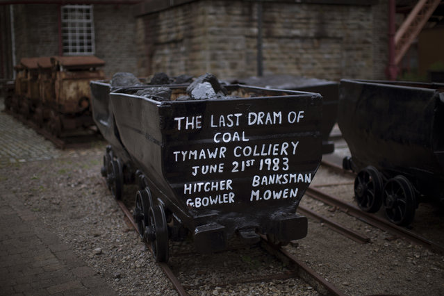 In this Thursday, June 30, 2016 photo, an old wagon filled with coal remains at the Rhondda Heritage Park, the former Lewis Menthyr Colliery in Pontypridd, South Wales. A modern highway connecting many former coal-mining towns in South Wales was partly funded by the European Union, but more than half of the Welsh electorate voted in last week's referendum for Britain to leave the EU, and maybe now the heavy industry which once provided thousands of jobs will never return. (Photo by Emilio Morenatti/AP Photo)