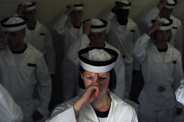 Bridget Devey learns how to wear her cover along with other plebes at Alumni Hall during Induction Day at the United States Naval Academy on Tuesday July 01, 2014 in Annapolis, MD. (Photo by Matt McClain/The Washington Post)