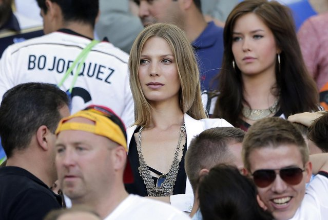 Sarah Brandner, the girlfriend of Germany's Bastian Schweinsteiger, waits for the start of the World Cup final soccer match between Germany and Argentina at the Maracana Stadium in Rio de Janeiro, Brazil, Sunday, July 13, 2014. (Photo by Matthias Schrader/AP Photo)