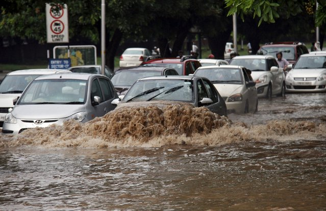 Vehicles move along a flooded road after a heavy rain downpour in Chandigarh, India, August 10, 2015. India has received 6 percent lower rainfall than usual, but in some areas rainfall deficit is as high as 57 percent, India Meteorological Department (IMD) data showed. (Photo by Ajay Verma/Reuters)