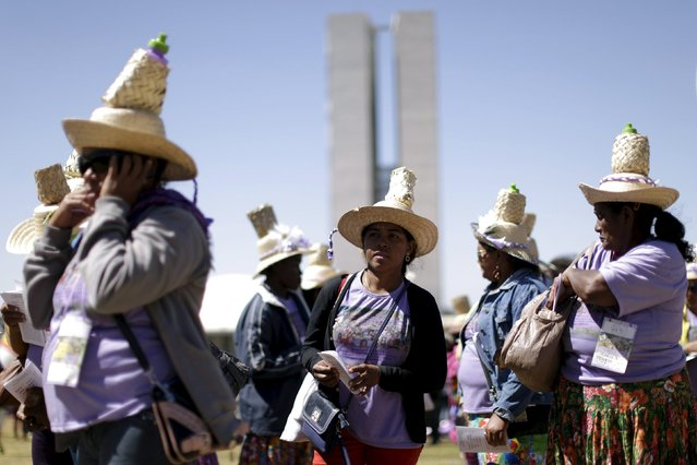 Women take part in the March of the Daisies, calling for improved rights for women working in rural areas and forests, in Brasilia August 12, 2015. (Photo by Ueslei Marcelino/Reuters)