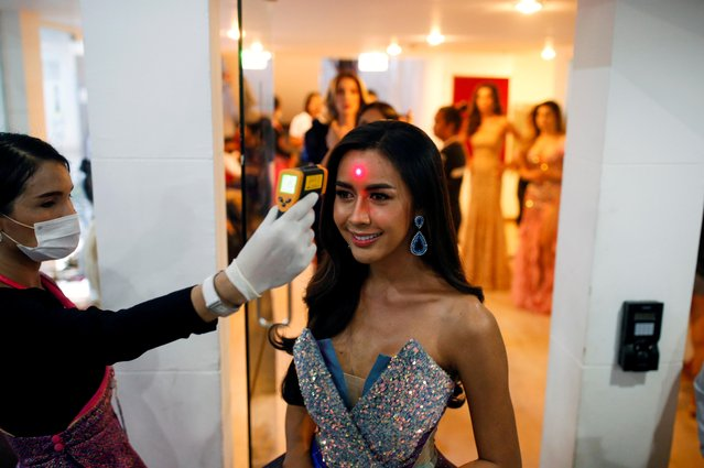 Aliya Sirisopha of Laos has her temperature checked before the final show of the Miss International Queen 2020 transgender beauty pageant in Pattaya, Thailand on March 7, 2020. Organizers had advised anyone who felt unwell not to attend. To allay coronavirus worries, the entire venue in the seaside resort city of Pattaya was disinfected the day before the event by staff in protective suits. The contestants all had their temperatures taken with hand scanners before being allowed to go on stage in national costumes, swimsuits and glamorous evening gowns. (Photo by Soe Zeya Tun/Reuters)