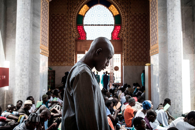 A Muslim worshipper attends a  mass prayer against COVID-19, the new coronavirus, in Dakar on March 4, 2020, after two cases were confirmed in Senegal in the previous days. Across the world, 3,155 people have died from the virus. More than 92,723 have been infected in 78 countries and territories, according to AFP's latest toll based on official sources at 1700 GMT on March 3, 2020. (Photo by John Wessels/AFP Photo)