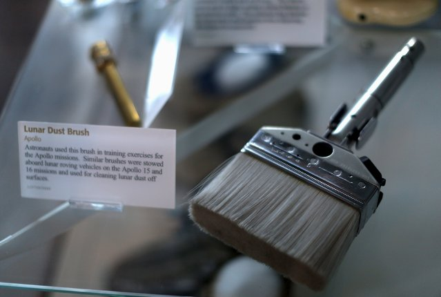 A lunar dust brush used for Apollo mission training is seen on display at the Udvar-Hazy Smithsonian National Air and Space Annex Museum in Chantilly, Virginia August 28, 2015. (Photo by Gary Cameron/Reuters)
