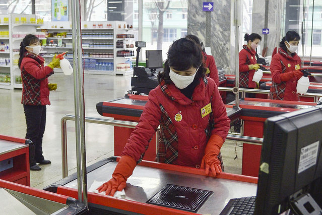 "In this Friday, February 28, 2020, photo, clerks disinfect checkout counters at a department store amid growing concern over the coronavirus outbreak in Pyongyang, North Korea. North Korean leader Kim Jong Un has called for stronger anti-virus efforts to guard against COVID-19, saying there will be ""serious consequences"" if the illness spreads to the country. (Photo by Kyodo News via AP Photo)"