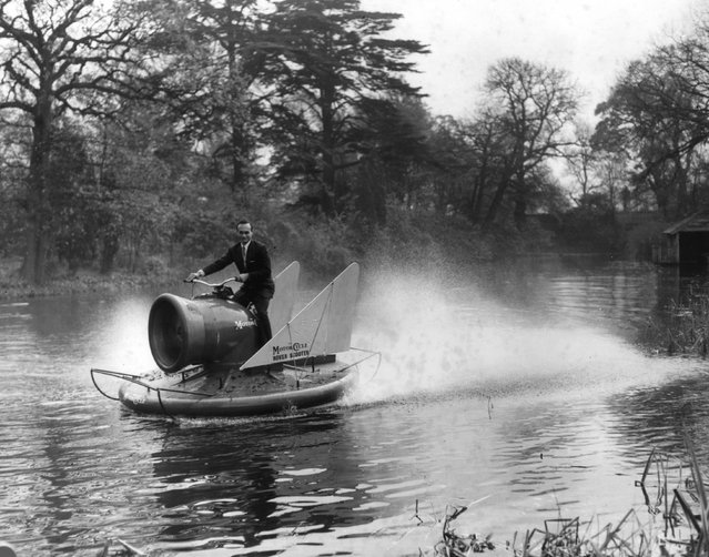 Carl Mikan, chief engineer of the Hover Scooter project, pilots the vehicle over water at Long Ditton, Surrey, 9th November 1960. The scooter rides on a six inch cushion of air and is driven by a 250cc twin cylinder two stroke motor cycle engine.  (Photo by Harry Todd/Fox Photos)