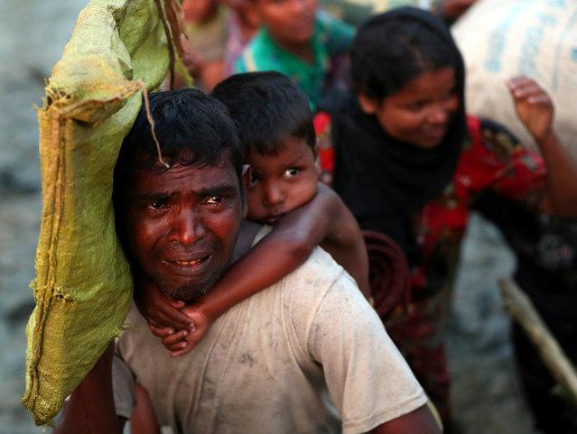 A Rohingya refugee man cries while crossing the Naf River as he moves across the Myanmar-Bangladesh border in Palong Khali, near Cox's Bazar, Bangladesh on November 1, 2017. (Photo by Hannah McKay/Reuters)