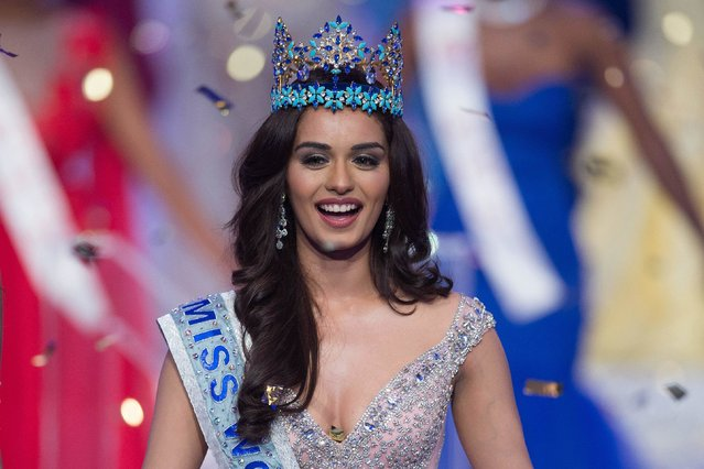 Miss India Manushi Chhilar smiles as she wins the 67 th Miss World contest final in Sanya, on the tropical Chinese island of Hainan on November 18, 2017. (Photo by Nicolas Asfouri/AFP Photo)