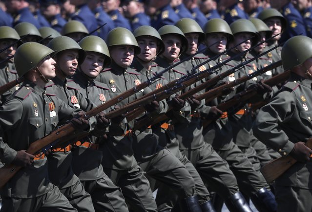 Russian soldiers dressed in Red Army World War II uniforms march toward Red Square during the Victory Day military parade marking the 75th anniversary of the Nazi defeat in Moscow, Russia, Wednesday, June 24, 2020. (Photo by Pavel Golovkin/AP Photo/Pool)