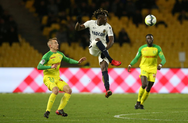 Monaco's Kevin N'Doram in action with Nantes' Valentin Rongier during the French L1 football match Nantes vs Monaco at the La Beaujoire stadium in Nantes, western France, on November 29, 2017. (Photo by Stephane Mahe/Reuters)