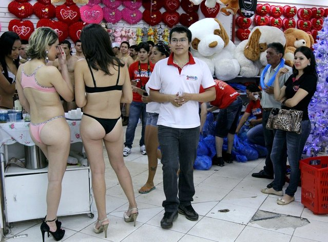 Customers in underwear shop during a special promotion at a mall in Ciudad del Este, Paraguay, on December 2, 2012. (Photo by Jose Espinola/AFP Photo)