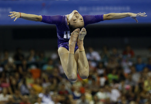 China's Yao Jinnan competes in the women's balance beam final of the Artistic Gymnastics World Championship at the Guangxi Gymnasium in Nanning, capital of southwest China's Guangxi Zhuang Autonomous Region Sunday, October 12, 2014. (Photo by Andy Wong/AP Photo)