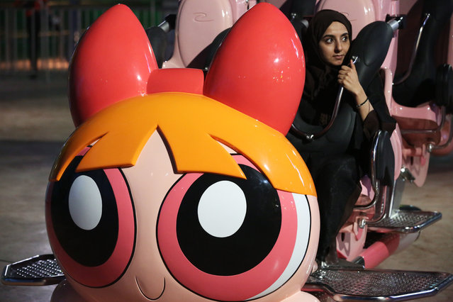 A woman waits for the Powerpuff Girls – Mojo Jojo's Robot Rampage ride to begin at the IMG Worlds of Adventure amusement park in Dubai, United Arab Emirates, on Wednesday, August 31, 2016. in Dubai, United Arab Emirates, on Wednesday, Aug. 31, 2016. The IMG Worlds of Adventure indoor theme park opened Wednesday in Dubai, hoping to draw thrill seekers to its air-conditioned confines. (Photo by Jon Gambrell/AP Photo)