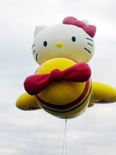 """In this photo provided by Macy's, the """"Hello Kitty"""" balloon floats over the Meadowland's race track during a test flight Saturday, November 10, 2012, in East Rutherford, N.J. (Photo by AP Photo/Macy's, Inc.)"""
