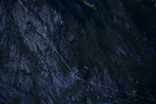Alex Schultz of Germany walk on a line during the Highline Extreme event in Moleson, Switzerland September 25, 2015. (Photo by Denis Balibouse/Reuters)