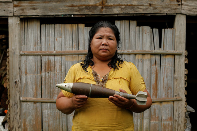 Toui Bounmy Sidavong, 43, holds a bomb dropped by the U.S. Air Force planes during the Vietnam War, in the village of Ban Napia in Xieng Khouang province, Laos September 3, 2016. Addressing the legacy of war in Laos will be a focus of U.S. President Barack Obama's trip this week to the country's capital, Vientiane, for a meeting with Association of Southeast Asian Nations (ASEAN) leaders and an East Asia Summit. Obama, who will become the first sitting president of the United States to visit Laos, is expected to announce more funding to help clear leftover bombs and conduct Laos' first national survey on unexploded ordnance. From 1964 to 1973, U.S. warplanes dropped more than 270 million cluster munitions on Laos, one-third of which did not explode, according to the Lao National Regulatory Authority for UXO (NRA). (Photo by Jorge Silva/Reuters)