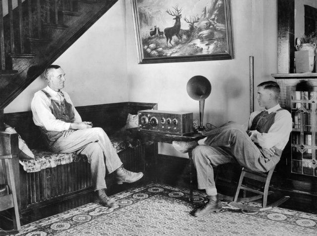 """Farmer and his son listening in the evenings, Shawnee county, Kansas, September 23 or 24, 1924"". (Photo by George W. Ackerman)"