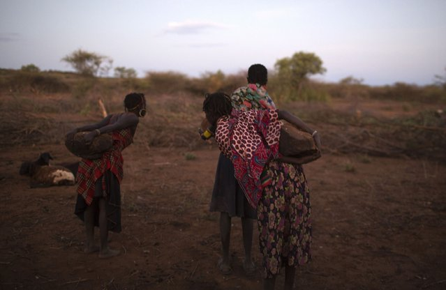 Pokot women place stones where girls will be seated to undergo their circumcision rite, about 80 kilometres from the town of Marigat in Baringo County, October 16, 2014. (Photo by Siegfried Modola/Reuters)