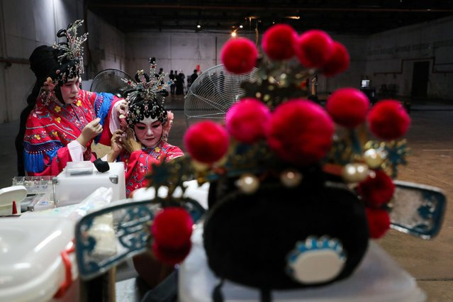 Traditional Chinese opera actresses prepare for an online streaming video recording at a studio, amid the coronavirus disease (COVID-19) outbreak, in Kuala Lumpur, Malaysia on June 27, 2020. (Photo by Lim Huey Teng/Reuters)