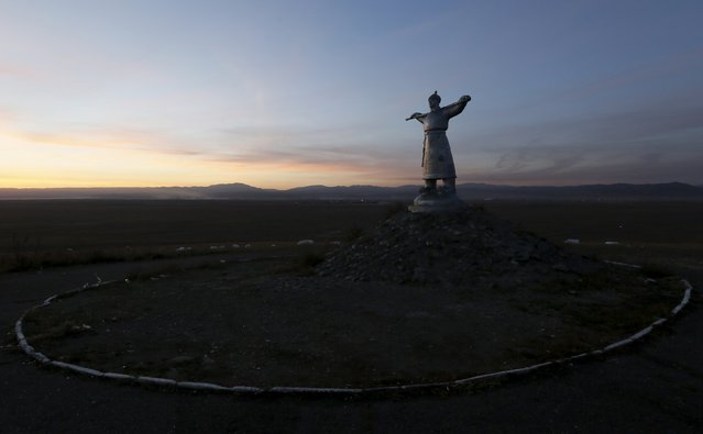 A sculpture of Arat, a Tuvan cattle breeder, is seen in the steppe outside the town of Kyzyl, administrative centre of Tuva region, Southern Siberia, Russia, October 10, 2015. Tuva region is inhabited by Tuvans, historically cattle-herding nomads, who nowadays practise two main confessions - Buddhism and Shamanism. (Photo by Ilya Naymushin/Reuters)