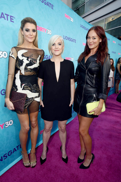 """Grace Helbig, Hannah Hart and Writer/Actor Mamrie Hart seen at Lionsgate Premiere of """"Dirty 30"""" at ArcLight Cinemas on Tuesday, September 20, 2016, in Los Angeles. (Photo by Steve Cohn/Invision for Lionsgate Home Ent./AP Images)"""