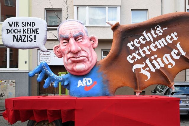 """A carnival float, depicting co-leader of the parliamentary group of the Alternative for Germany (AfD) far-right party Alexander Gauland, is pictured during a carnival parade on Rose Monday on February 12, 2018 in Duesseldorf, western Germany. The writings read """"We are not nazis at all"""" (L) and """"far-right wing"""" (R). Germany. (Photo by Patrik Stollarz/Getty Images)"""